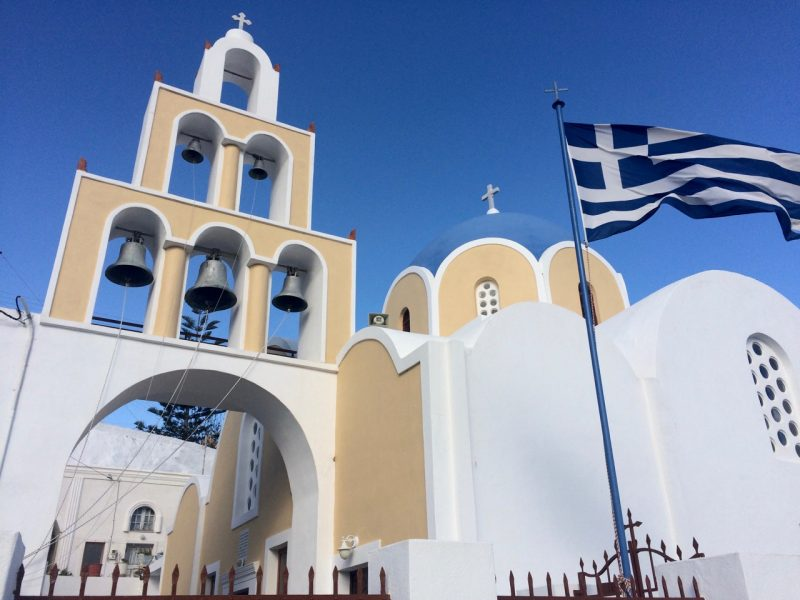 Whitewashed church with its blue dome in Santorini.