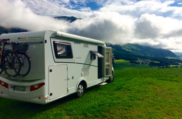Motorhome parked on a mountain overlooking a valley