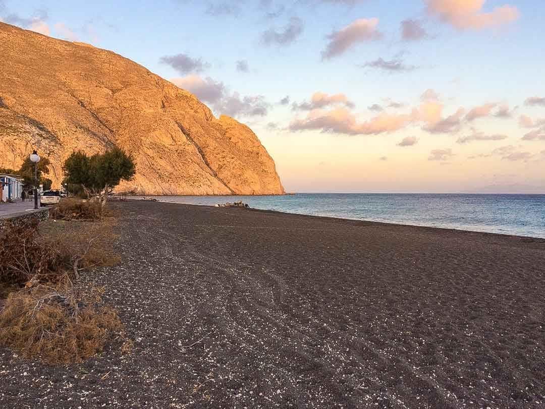 sands of Perissa Beach in Santorini