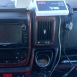 motorhome tip for beginners no. 7 Campervan dashboard showing a white inverter connected to the 12V socket