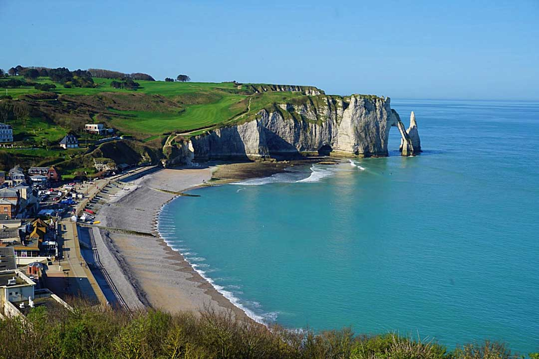 Etretat beach woth rock formation at end in Normandy