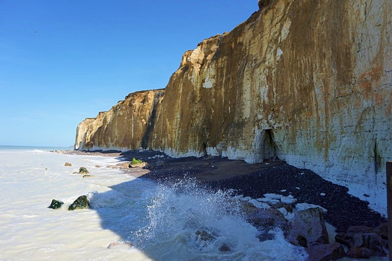 white limestone cliffs and the sea pounding them from below