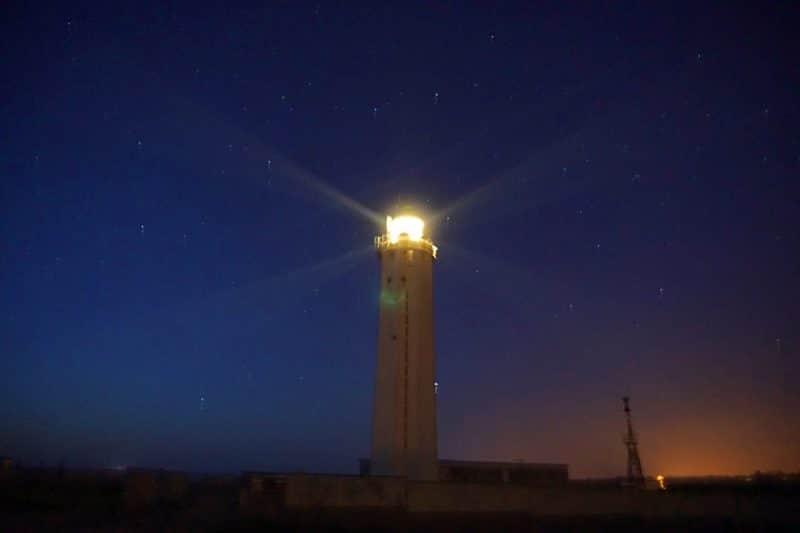 Cap d'Antifer lighthouse beaming its light at night