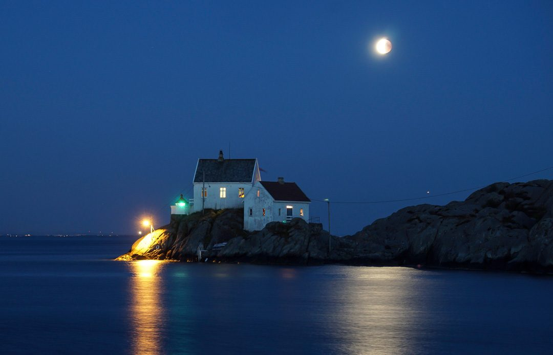 moon above lighthouse