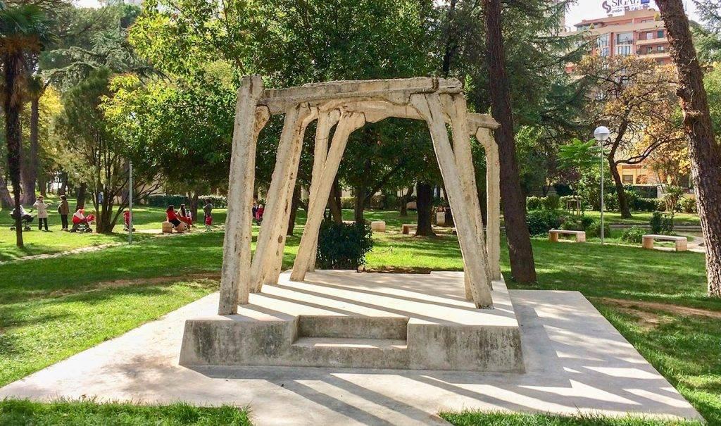 A arch like design made of cream colour pillars in Tirana, Albania