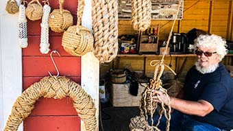 Local rope maker at his stall at the Skudeneshavn Tall Ships Festival