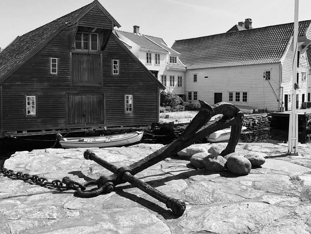 Black and white photo of boathouse and anchor in Skudeneshavn