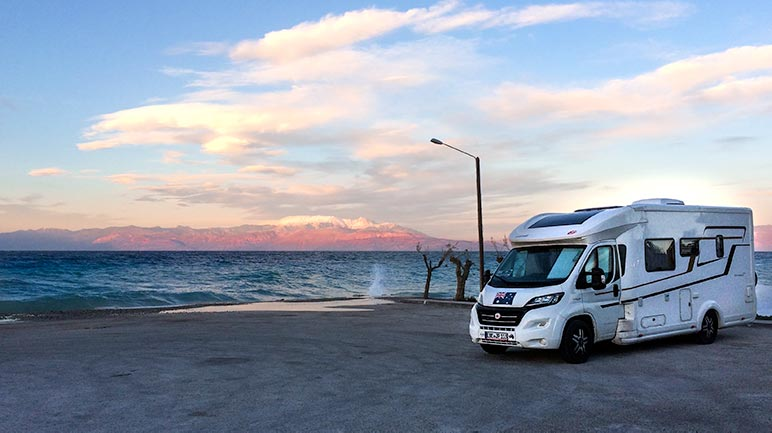 Campervan parked by the Ocean in Greece
