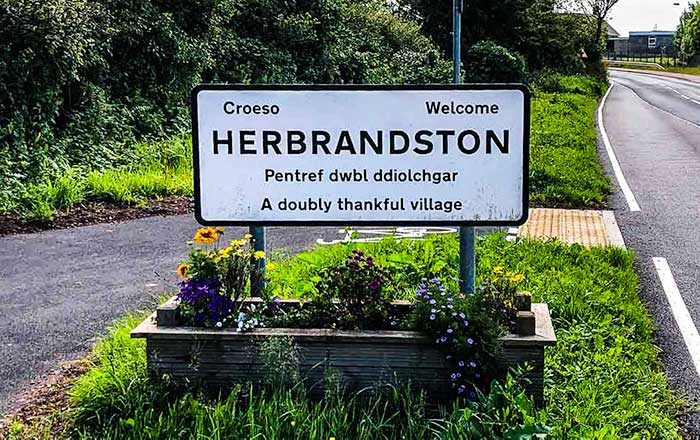 SIgn for the town of Herbrandstone in Pembrokeshire, Wales .