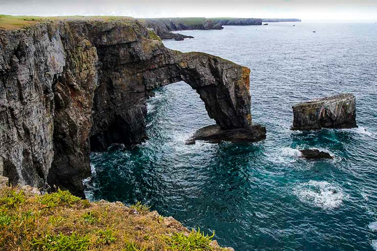 'The Green Bridge of Wales' rock formation in Wales
