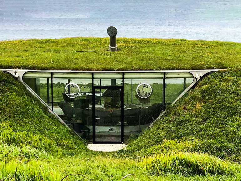 Tellytubby House in Wales with ocean in the  background.