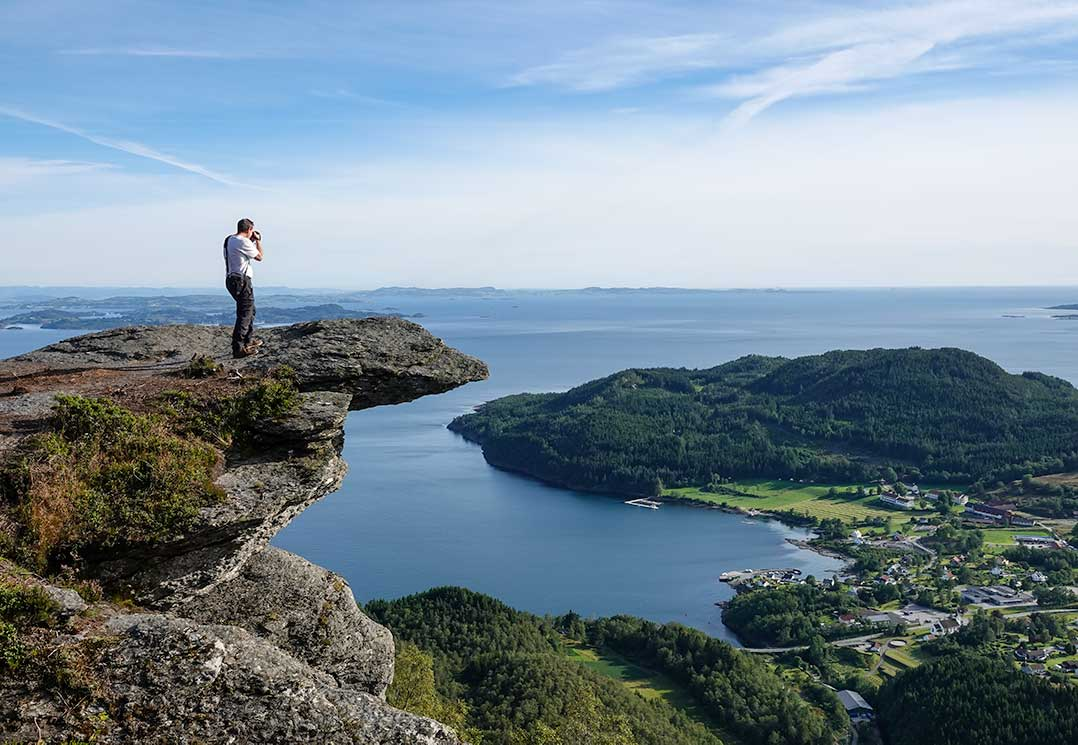 Lars taking photo over the fjord from the Himakana precipice - Hiking Norway