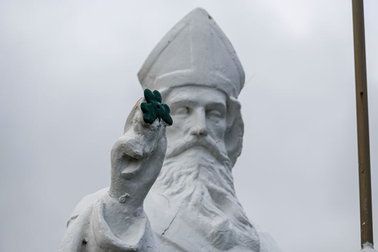 Statue holding a shamrock