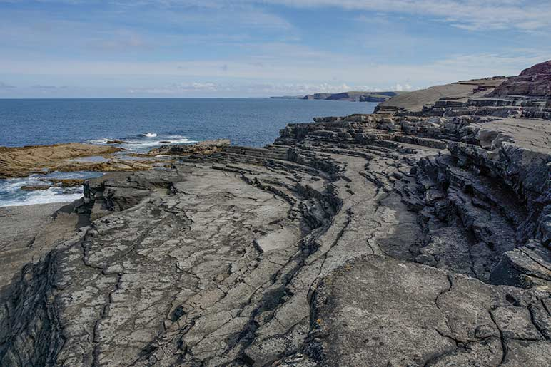 Ampitheatre Kilkee Cliff - Multiple rock ledges leading to the water looking like an amphitheatre