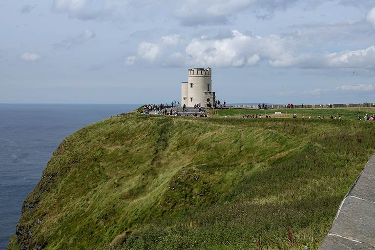 White stone tower at a promontory at the Cliffs of Moher