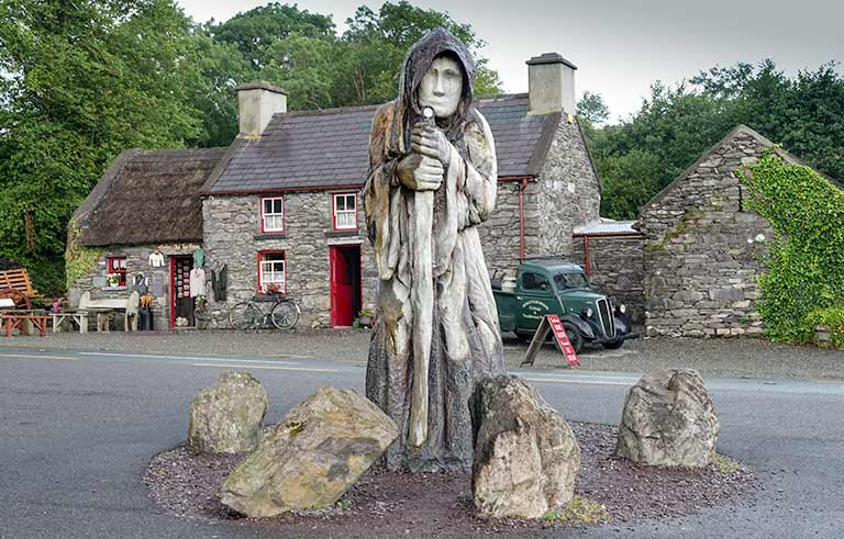 Day 2 of our 7 day Ireland Itinerary -Statue of Molly Gallivan beside the road and in front of her home