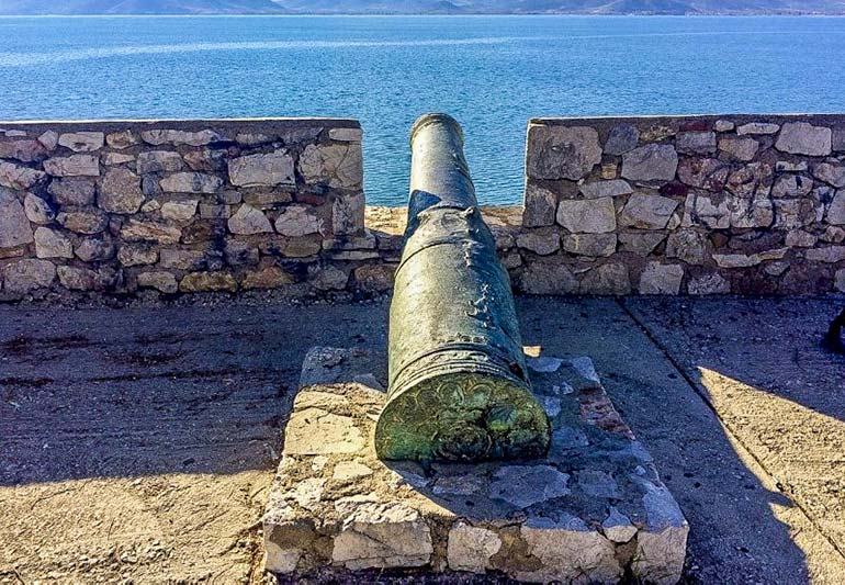 One of the 'Five Brothers' cannons lying in wait on the old walls of Nafplio