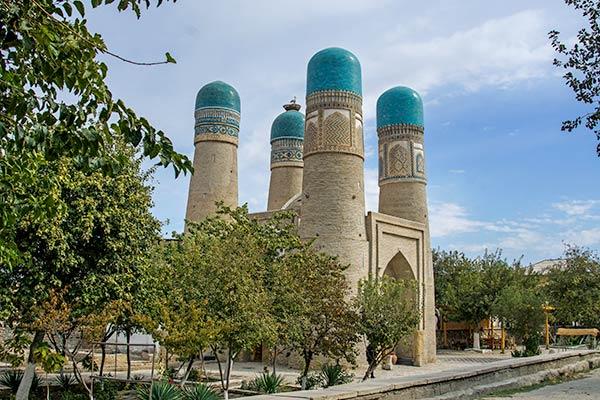 small 4 blue domed madrasah