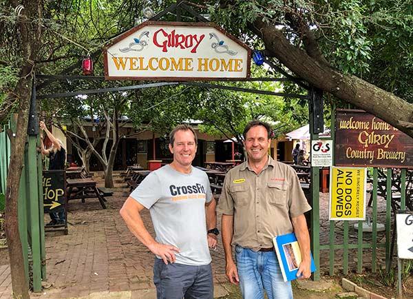 2 guys standing outside Gilroy's pub