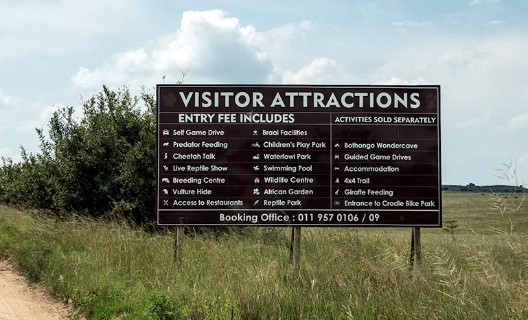 List of visitor attractions on the sign at the Rhino and Lion Park