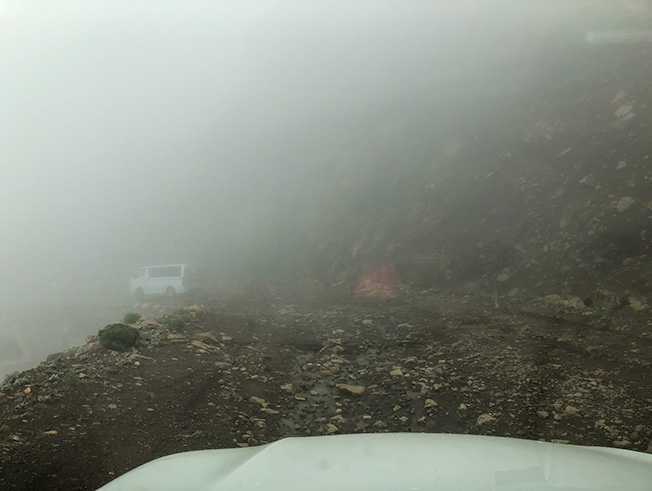 Following another vehicle on the rocky Sani Pass descent