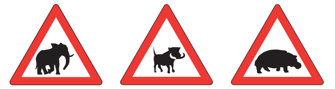 wild animals signpost on the road - elephant, warthog and hippo
