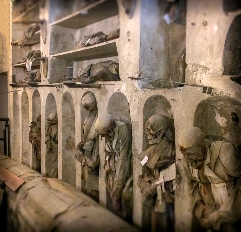 Rows of dressed corpses in the catacoms of palermo Sicily