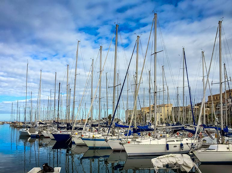 Palermo Harbour with yachts lined up in a row