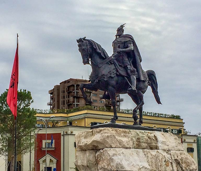 Statue in a square of a man on a horse