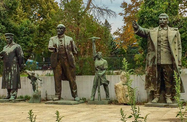 Bronze abandoned statues of the Russian communist regime