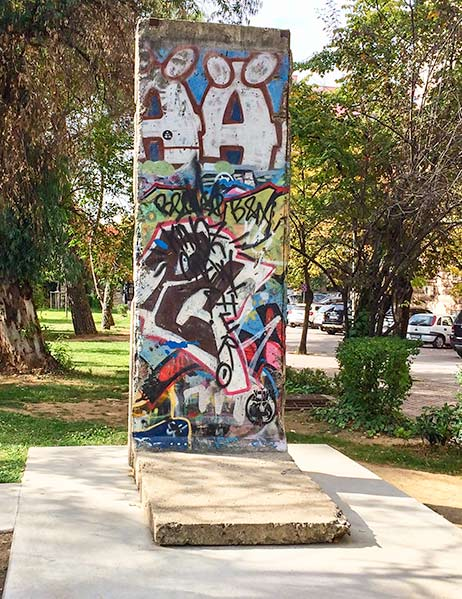 A piece of the concrete Berlin with graffiti on it, Albania Road Trip