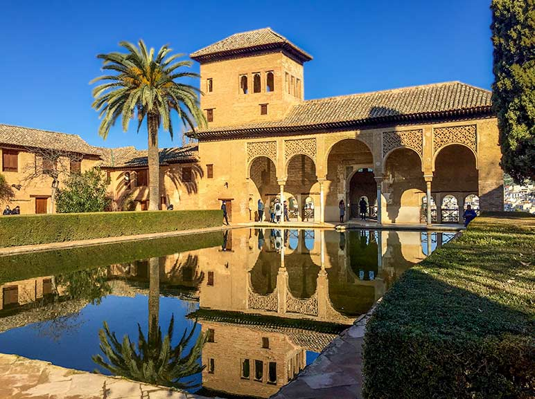 Alhambra Tranquility pool in front of arched columnar building