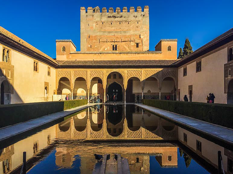 Alhambra in Granada Spain - Building with a long pool in front of it