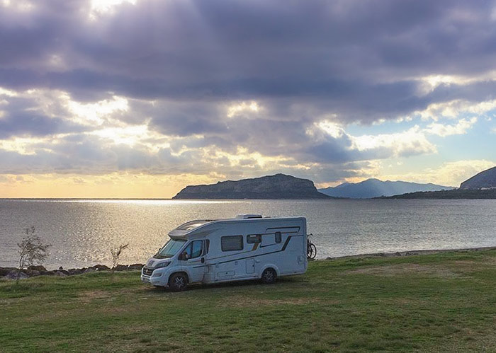 That feeling of freedom .. campervan on a beach with a sunset