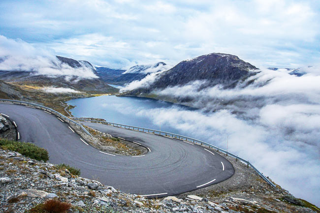 winding road overlooking a fjord