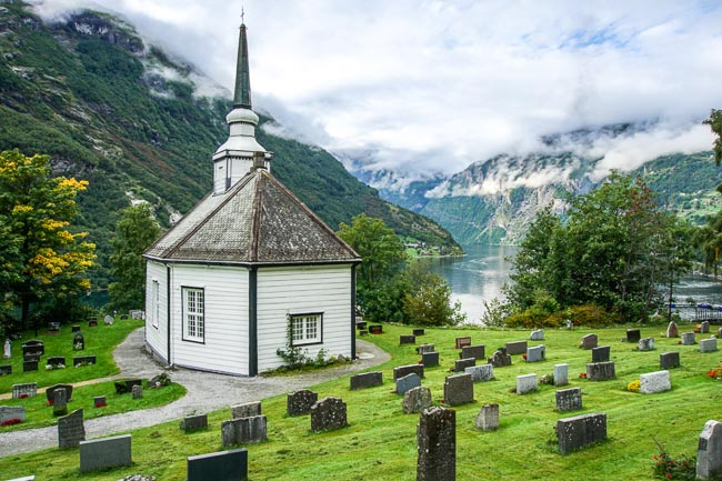white octagonal church overlooking a fjord
