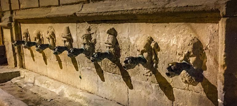 8 water spouts that are gorgoyle heads in Santa Coloma de Queralt