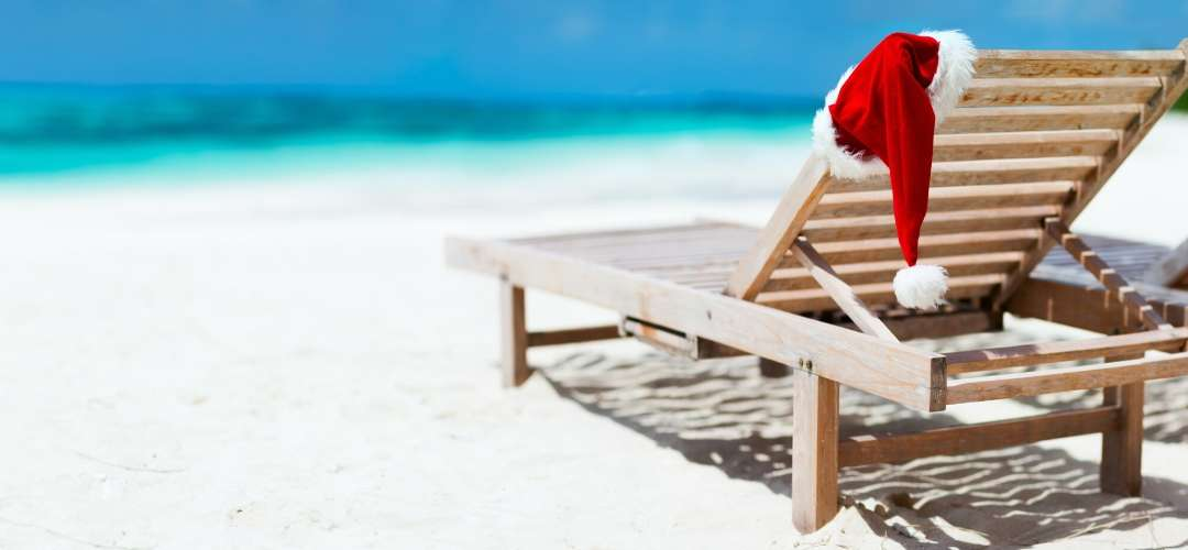 Christmas hat on a sunbed at the beach