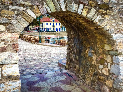 Nafpaktos harbour wall with view through to the harbour