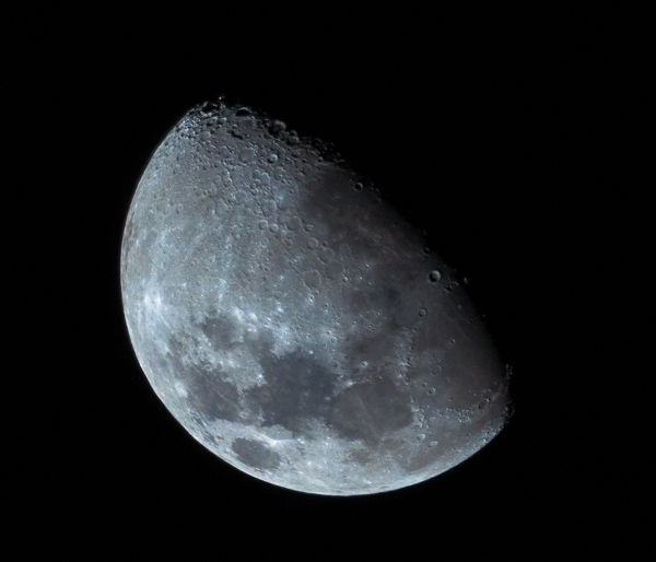 Nighttime shot of the moon during the waxing phase