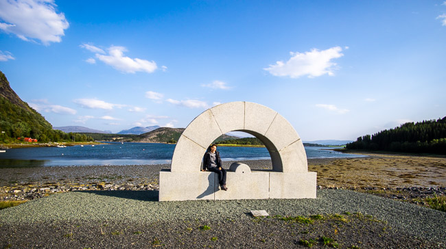 sculpture of a protractor near the waters edge