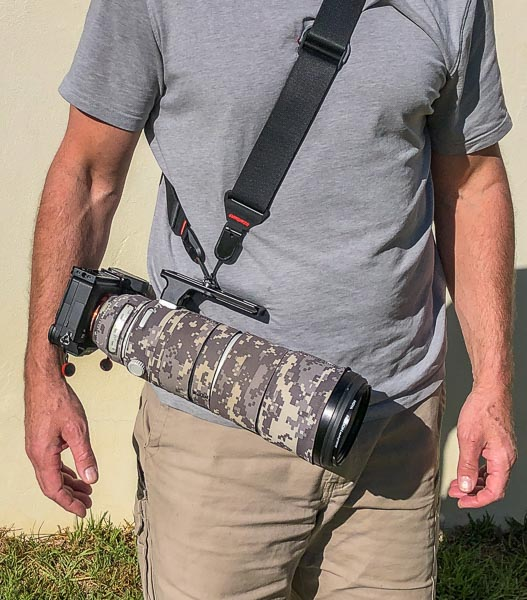 Sony camera and lens carried with a shoulder strap