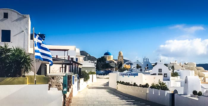 Blue-and-white-buildings-with-greek flag