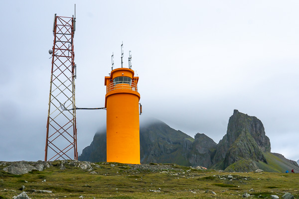 Hvalnes orange lighthouse with a mountain background, Iceland