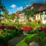Hirtzbach timbered houses beside a flower lined river