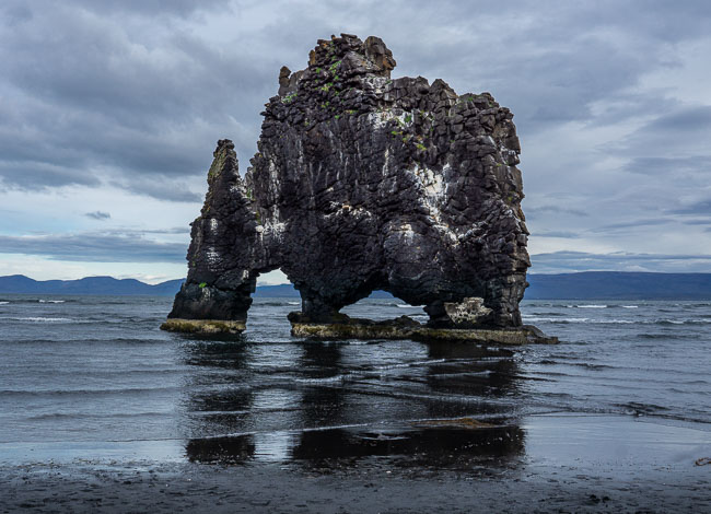 rock arch in the sea that looks like a dragon drinking, iceland