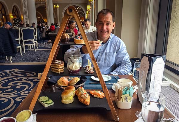 High-tea-at-Lake-Louise - a triangular stand with a selection of cakes and sandwiches