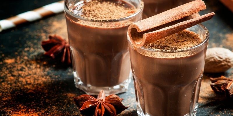 Two glasses of hot chocolate with cinnamon sprinkles  photo