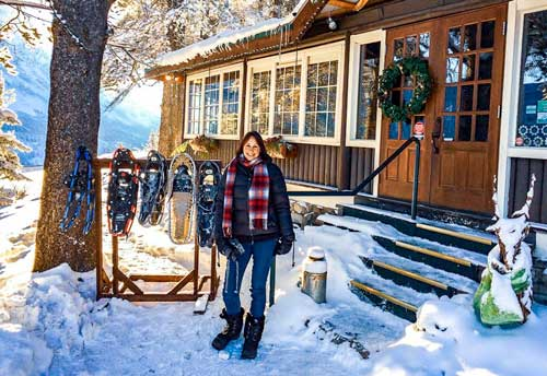 Log-cabin-and-snow-shoes and Shelley beside them