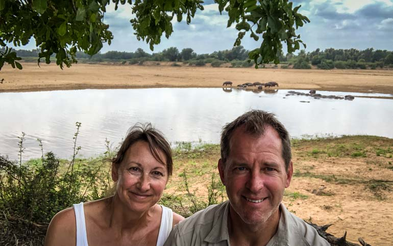 Lars and Shelley at crooks corner with river of hippos in the background